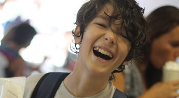Boy laughing in dining hall