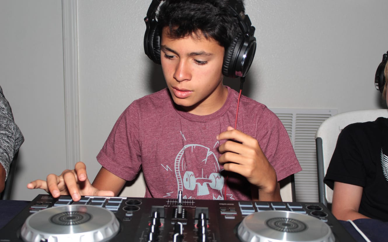 Boy learning to DJ