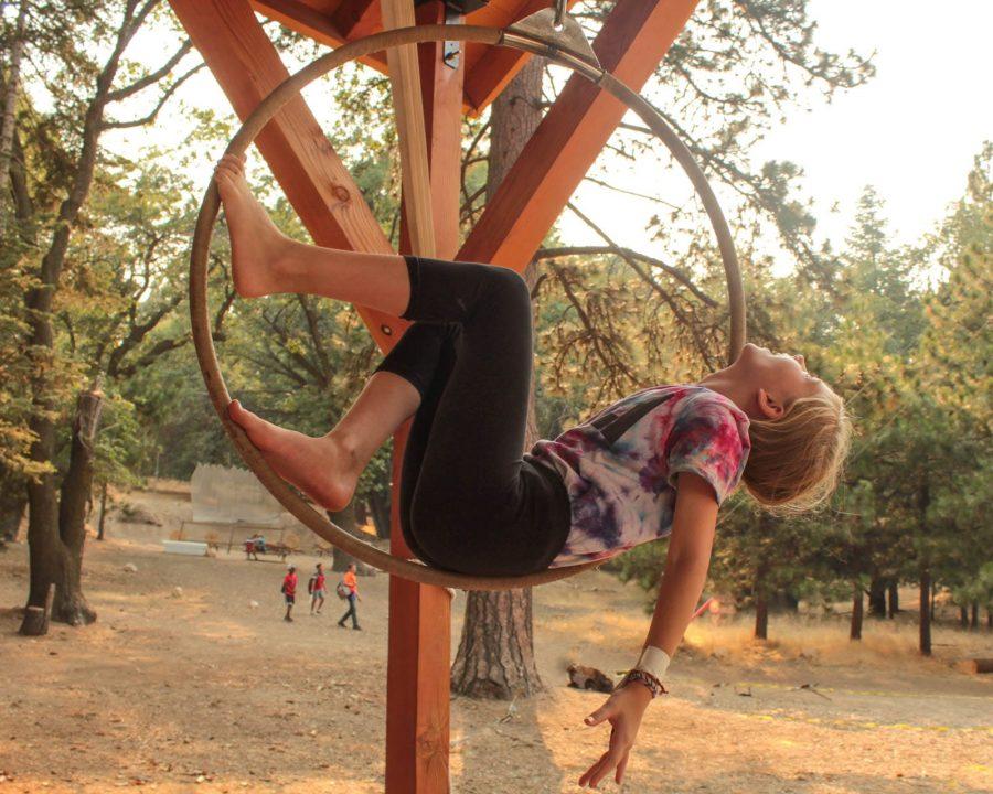 Girl on trapeze hoop