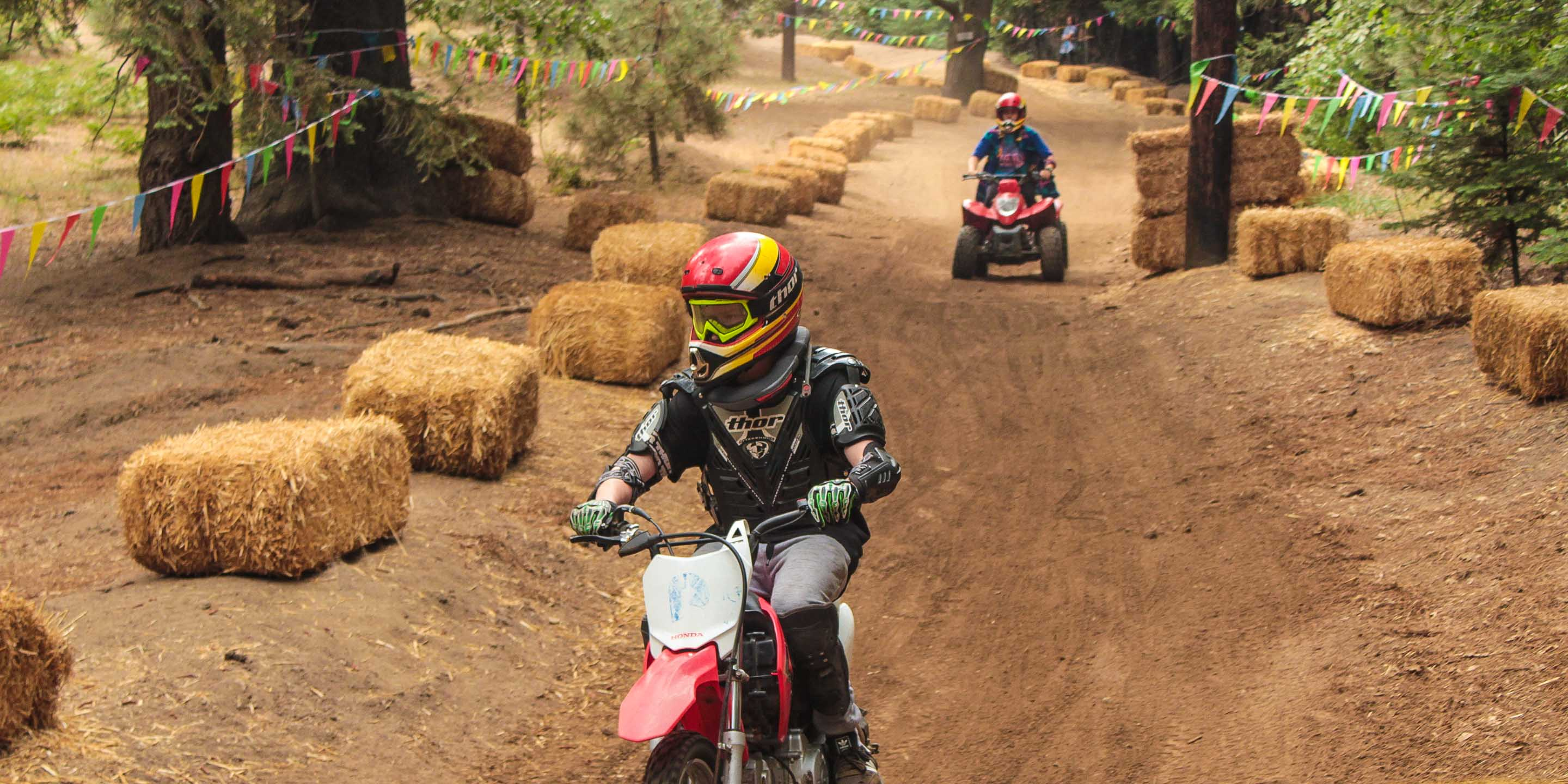 Custom dirt track with ATV and dirt bike